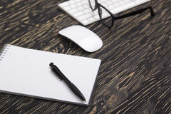 Opened notebook, glasses ,pen , modern computer keyboard and white mouse Stock Image