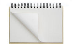 An opened notebook paper curled Royalty Free Stock Images