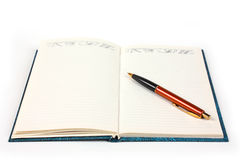 Opened notebook with pen Stock Image