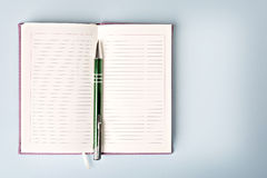 Opened notebook with pen Royalty Free Stock Image