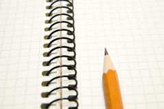 Opened notebook and pencil on over white Royalty Free Stock Photo