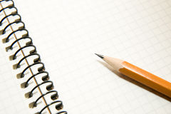 Opened notebook  and pencil on over white Stock Image