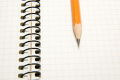 Opened notebook  and pencil on over white Royalty Free Stock Images