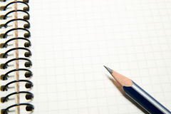 Opened notebook  and pencil on over white Royalty Free Stock Photos