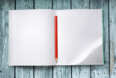Opened notebook with pencil Royalty Free Stock Photos