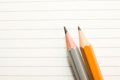 Opened notebook and pencils on the old tissue Royalty Free Stock Photo