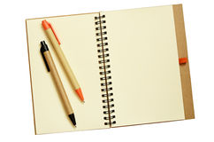 Opened notebook and pens Royalty Free Stock Images