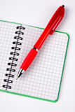 Opened notebook and red pen Royalty Free Stock Photo