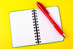 Opened notebook and red pen Stock Photography
