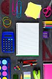 Opened notebook with school supplies frame on chalkboard Royalty Free Stock Photo