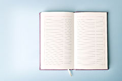 Opened notebook on the table Stock Images