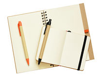 Opened notebooks and pens Stock Images