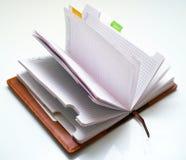 Opened notepad. On white background Stock Photos