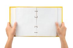 Opened notepad in hands Stock Photos