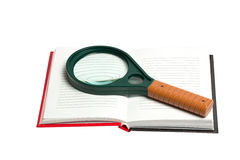 Opened notepad with magnifying glass isolated on white backgroun Stock Photo