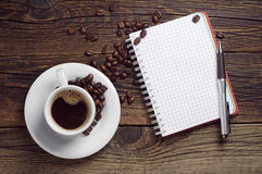 Opened notepad pen and coffee Royalty Free Stock Images