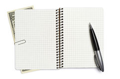 Opened notepad, pen and dollar Stock Photo