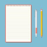 Opened notepad with pencil and pen Royalty Free Stock Image