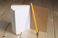 Opened notepad and pencil Stock Photo