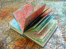 Opened old atlas book on the spread map Stock Image