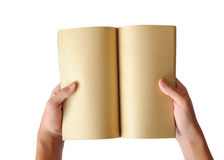 Opened old book in hands Royalty Free Stock Photo