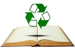 Opened old book with recycle symbol Stock Photo