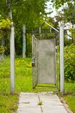 Opened Old Metal Gate In Garden. Royalty Free Stock Photography