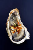 Opened oyster with chili and ginger Stock Images