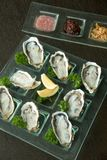 Oysters on glass plate with spicy sauce. Opened Oysters on glass plate with spicy sauce Stock Image