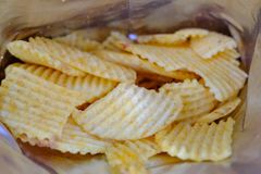 Opened pack of original taste delicious  potato chips Royalty Free Stock Photos