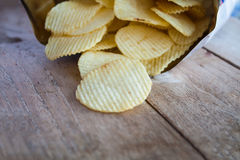 Opened pack with potato chips Royalty Free Stock Images