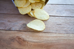 Opened pack with potato chips Stock Images
