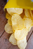 Opened pack with potato chips Royalty Free Stock Image