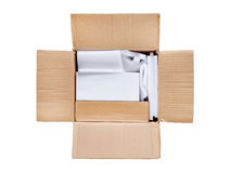 Opened package. Top view of open delivery with blank white box i Stock Photo