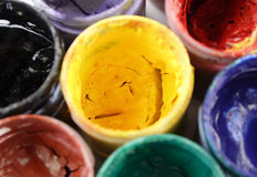 Opened paint buckets. With various colors Stock Photo