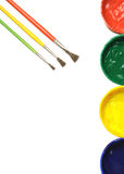 Opened paint buckets with brush