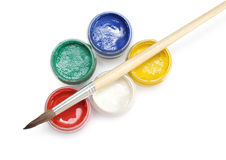 Opened paint buckets with brush Royalty Free Stock Images