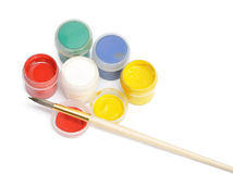 Opened paint buckets with brush Stock Image