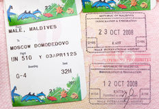 Opened passport with Maldives visa stamps and airline boading pass tickets.  Royalty Free Stock Photo