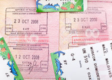 Opened passport with Maldives visa stamps and airline boading pass tickets.  Royalty Free Stock Photography