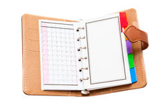 Opened personal organizer. Isolated on a white background Royalty Free Stock Images