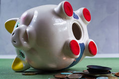 Opened piggy bank and coins -  business concept Royalty Free Stock Images