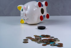 Opened piggy bank and coins -  business concept Stock Image
