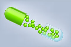 Opened pill Stock Image