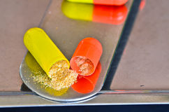 Opened pill with medicine powder Stock Images