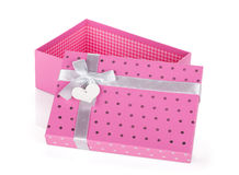 Opened pink gift box with ribbon and bow. Isolated on white background Royalty Free Stock Photo