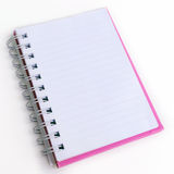 Opened pink note book. On white background Royalty Free Stock Photos