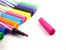 Opened pink with purple ink, multicolored magic colors, stationery Stock Images