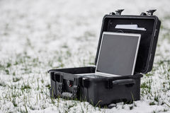 Opened plastic protector case with laptop lying on the grass an Stock Image