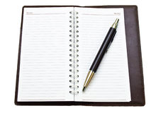 Opened pocket notebook and ballpen Stock Images